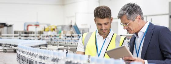 Man and auditor in bottling plant - NSF