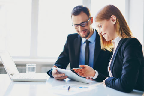 Man and woman in meeting - NSF Consulting Services
